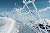 Safety net on ski run in italian alps — Stock Photo