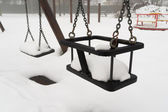 Swing in the snow — Stock Photo