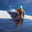 Man installing solar panels — Stock Photo #18719145