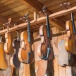 New and old violins in workshop - Stock Photo