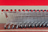 Row of empty shopping carts in supermarket — Stock Photo