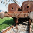 Rusty train on rails - Stock Photo