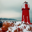 Red lighthouse in winter, La Spezia harbor — Stock Photo