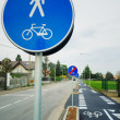 Bicycle and pedestrian shared route sign — Stock Photo