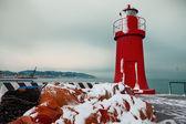 Red lighthouse in winter, La Spezia harbor — Stok fotoğraf