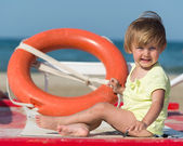 Happy little girl at the seaside in summer — Stock Photo