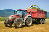 Farming red tractor — Stock Photo