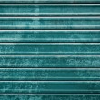 Closed teal roller door background — Stock Photo