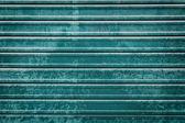 閉じたティール ローラーのドアの背景 — ストック写真