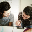 Two geeks gaming with smartphone — Stock Photo
