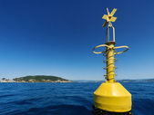 Yellow navigational buoy marker in sea — Stock Photo