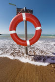 Buoy life saver on the beach — Foto Stock