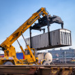 Crane lifts a container loading a train — Stock Photo
