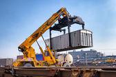 Crane lifts a container loading a train — ストック写真