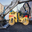Compactor roller in road in asphalting work — Stock Photo