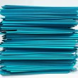 Stacks of cyan folders over white background — Stock Photo
