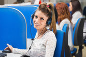Girl smiling in call center — Stock Photo