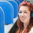 Female customer support operator with headset smiling — Stock Photo