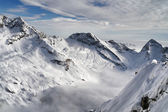 Aerial view of snow covered alps mountain in winter — Stock Photo