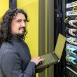 Man working with servers in data center — Stock Photo
