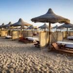 Sunbeds and beach umbrella in Marsa Alam, Egypt — Stock Photo #41106411