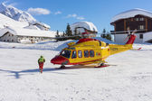 Rescue helicopter in mountain — Stock Photo