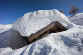 Mountain house covered with snow. Chiesa Valmalenco, Italy — Stock Photo