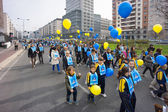 MILAN, ITALY - March 15: circa 30.000 children and parents join the Andemm al Domm parade on March 15, 2014 in Milan, Italy. — Stock Photo