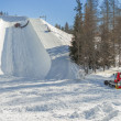 Ratrak during half pipe slope preparation for snowboard and ski — Stock Photo #43276579