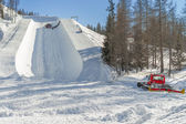 Ratrak during half pipe slope preparation for snowboard and ski — Stock Photo