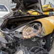 Yellow sport car crashed and burned — Stock Photo