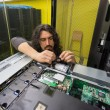 Man working with server in data center — Foto de Stock