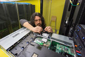Man working with server in data center — Foto Stock