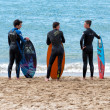 Cannes, France - APRIL 27, 2014: four young surfers waiting the right wave on the beach. — Stock Photo #45839993