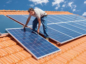 Installing alternative energy photovoltaic solar panels — Stock Photo