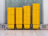 Pile of yellow shopping basket in super market — Foto de Stock