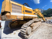 Excavator at a construction site — Stock Photo