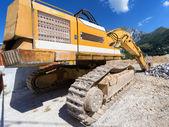 Grävmaskin på en byggarbetsplats — Stockfoto