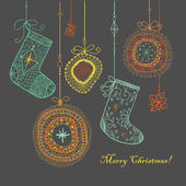 Christmas baubles and socks background. — Vecteur