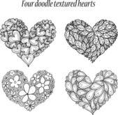 Doodle textured hearts set. — Stock Vector