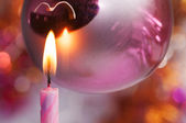 A candle with Christmas decorations close up — Stock Photo