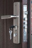 Door lock with keys — Stock Photo