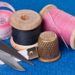 Sewing Kit on blue fabric - Stock Photo