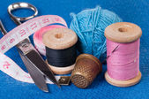 Sewing Kit on blue fabric — Stock Photo