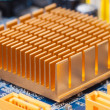 Stock Photo: Copper heat sink on computer motherboard