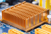 Copper heat sink on computer motherboard — Stock Photo