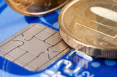 Credit card en munten — Stockfoto
