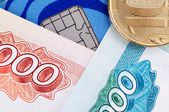 Credit card, banknotes and coins — Stock Photo