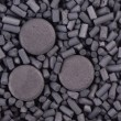 Activated carbon granules and tablets — Stock Photo