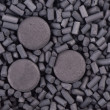 Stock Photo: Activated carbon granules and tablets